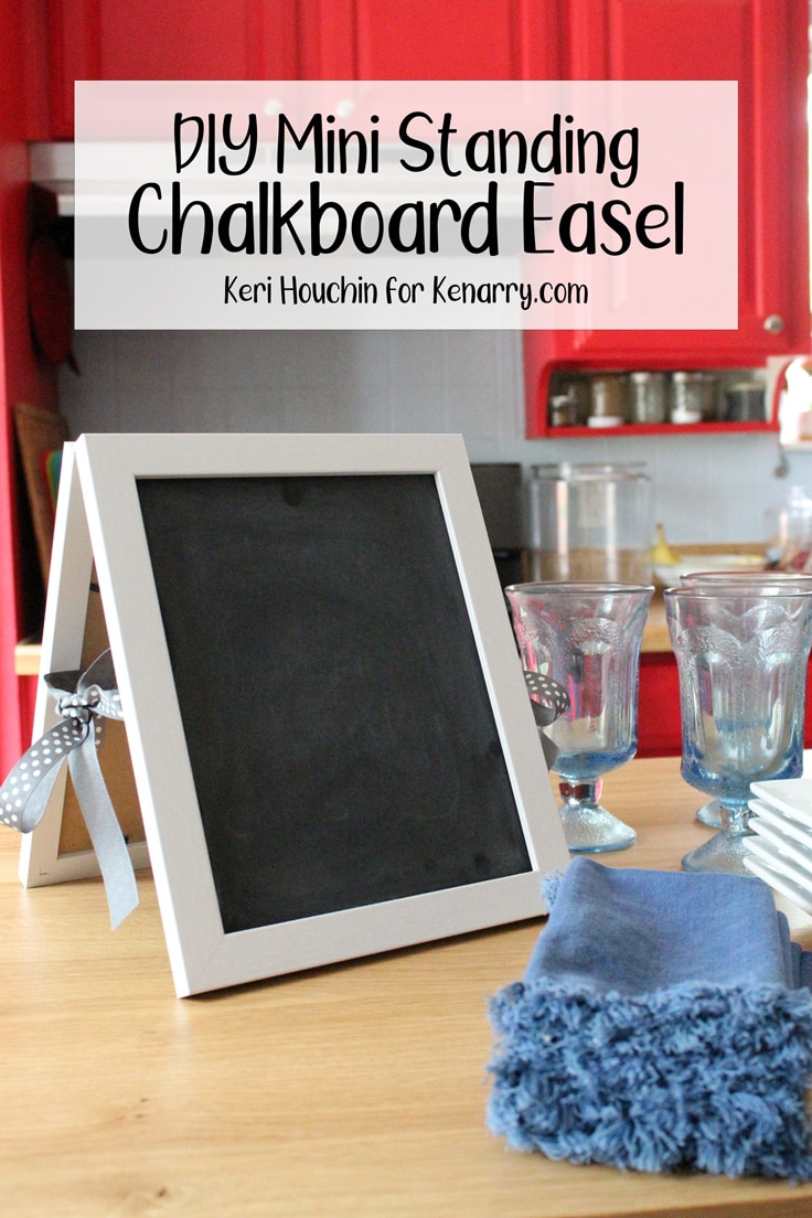 DIY mini standing chalkboard easel on a kitchen counter with dishes.