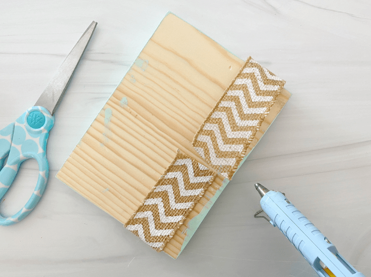 A burlap ribbon wrapped around the wood block.