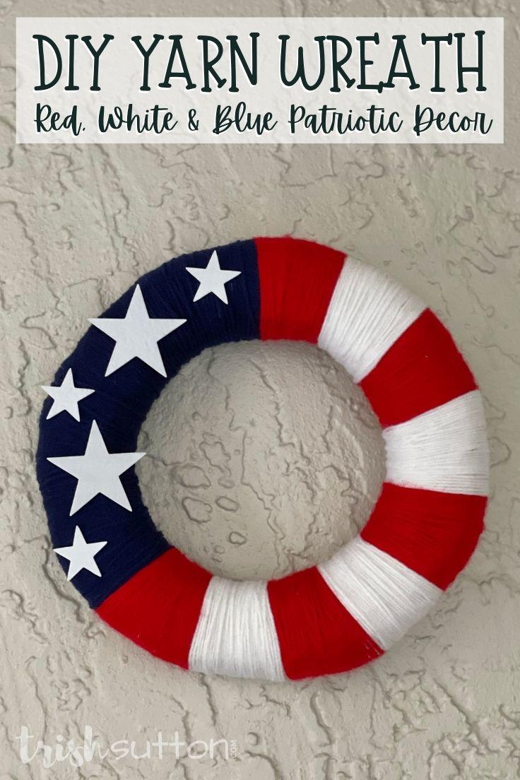 Stars and stripes DIY yarn wreath on a wood background.