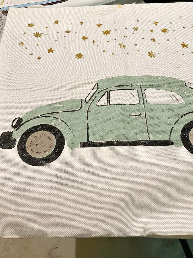 close up of finished diy throw pillow with vw bug