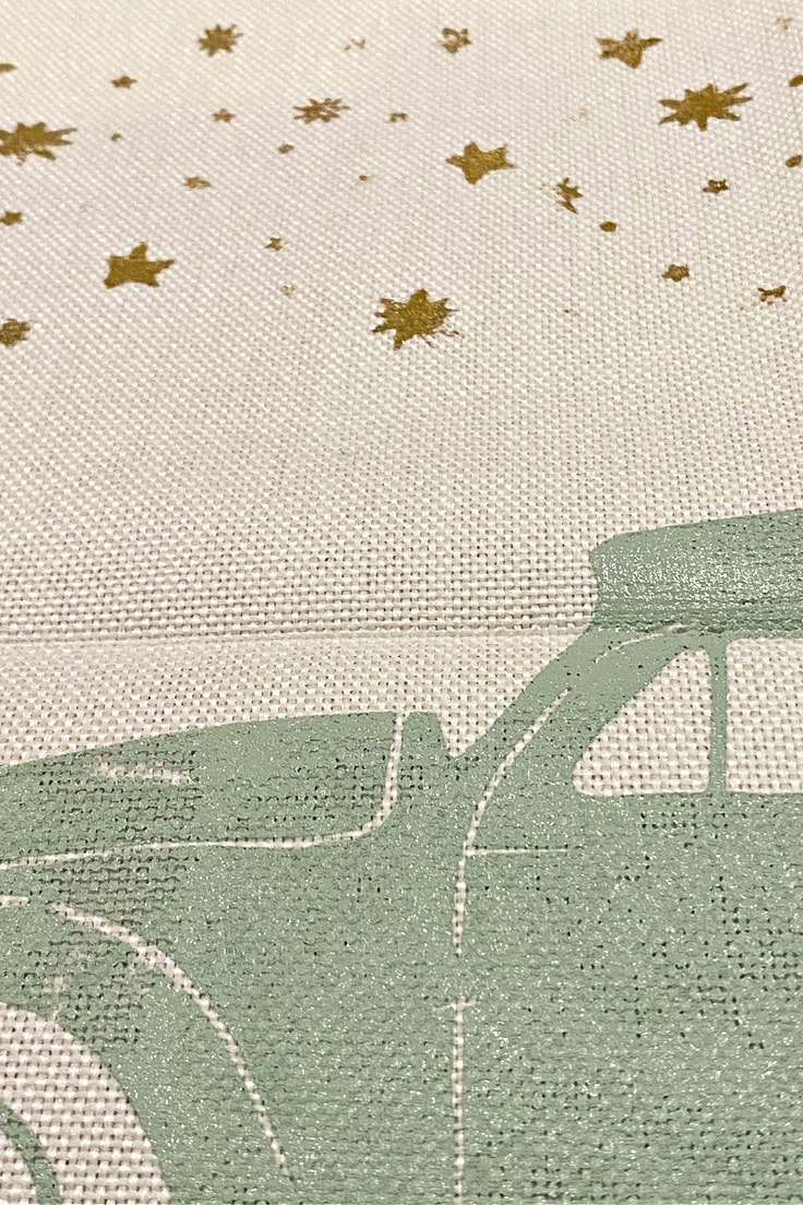 close up of gold stars on pillow