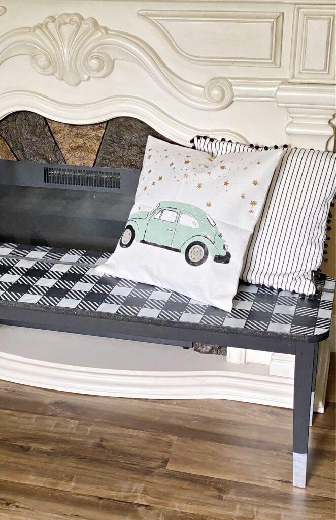 DIY Volkswagen Beetle throw pillow on an indoor bench.