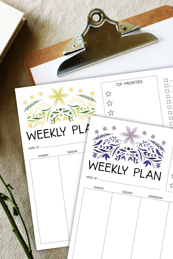 Preview of green and purple color weekly planner pages on top of clipboard on beige cloth background.