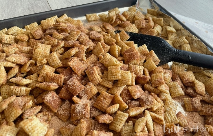 Pan of Cinnamon Sugar Chex Snacks ready to go in the oven.