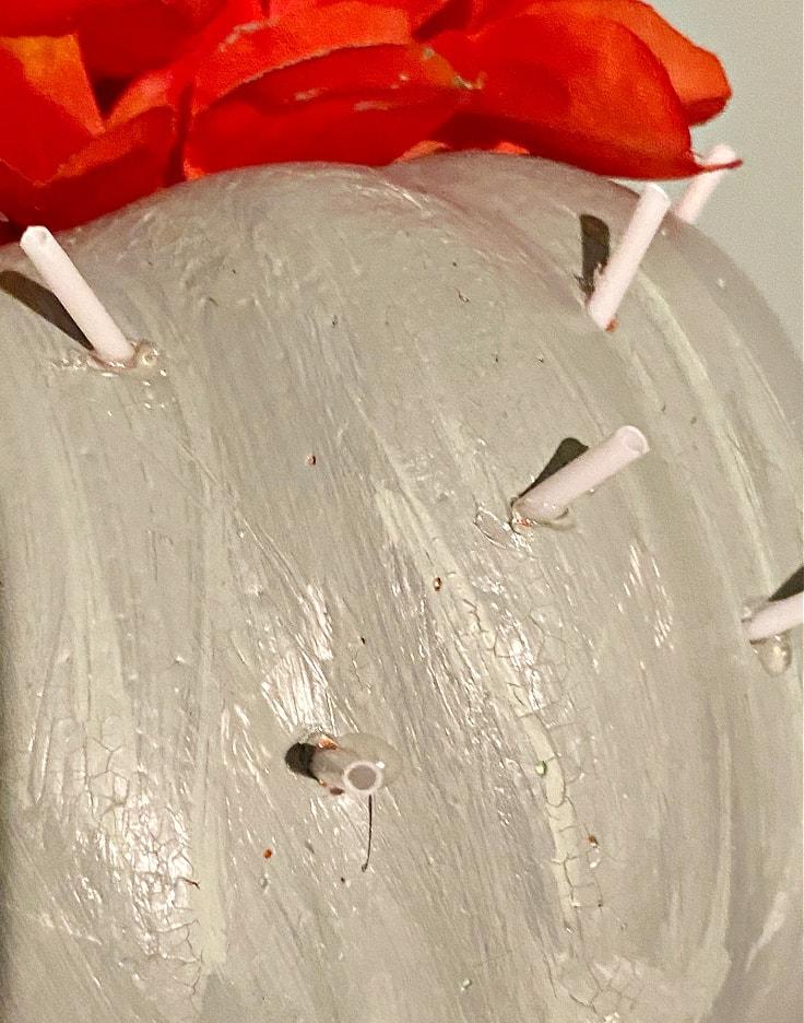 q-tips placed in foam pumpkin