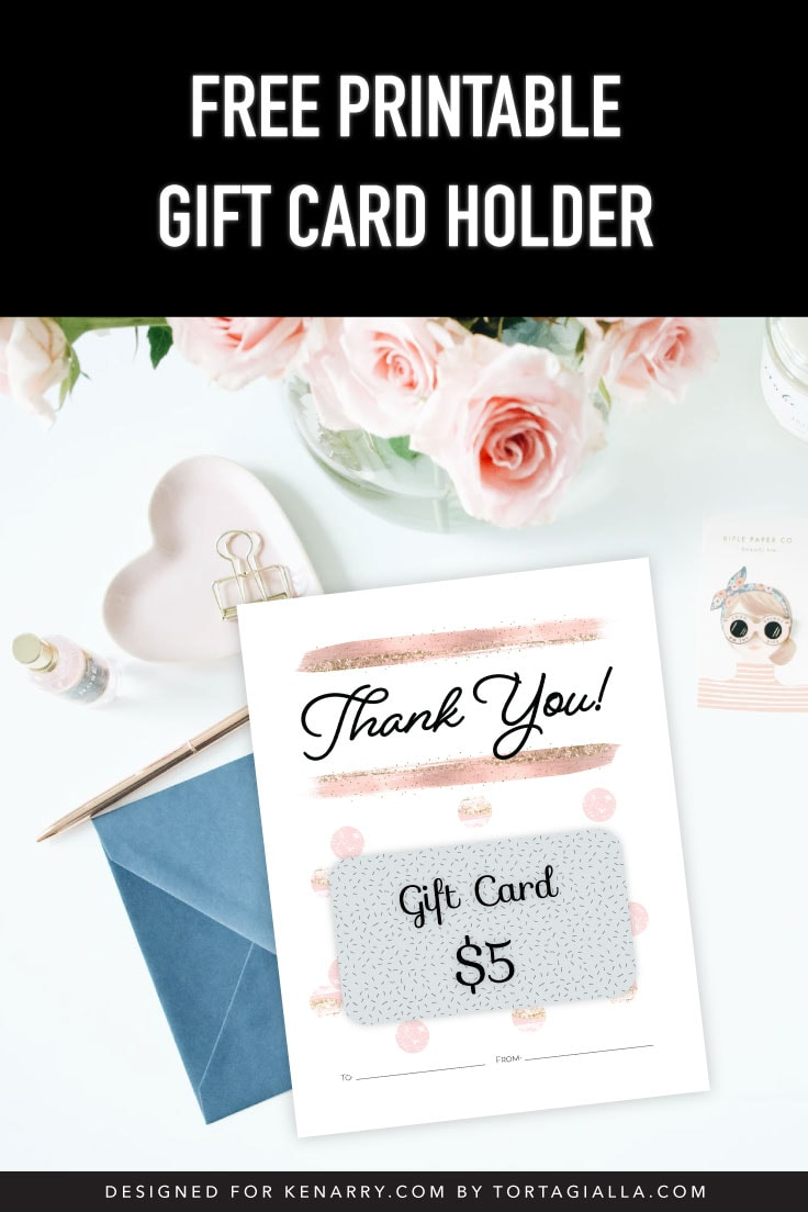 Preview of gift card design on white desk with stationery accessories and pink roses in the background.