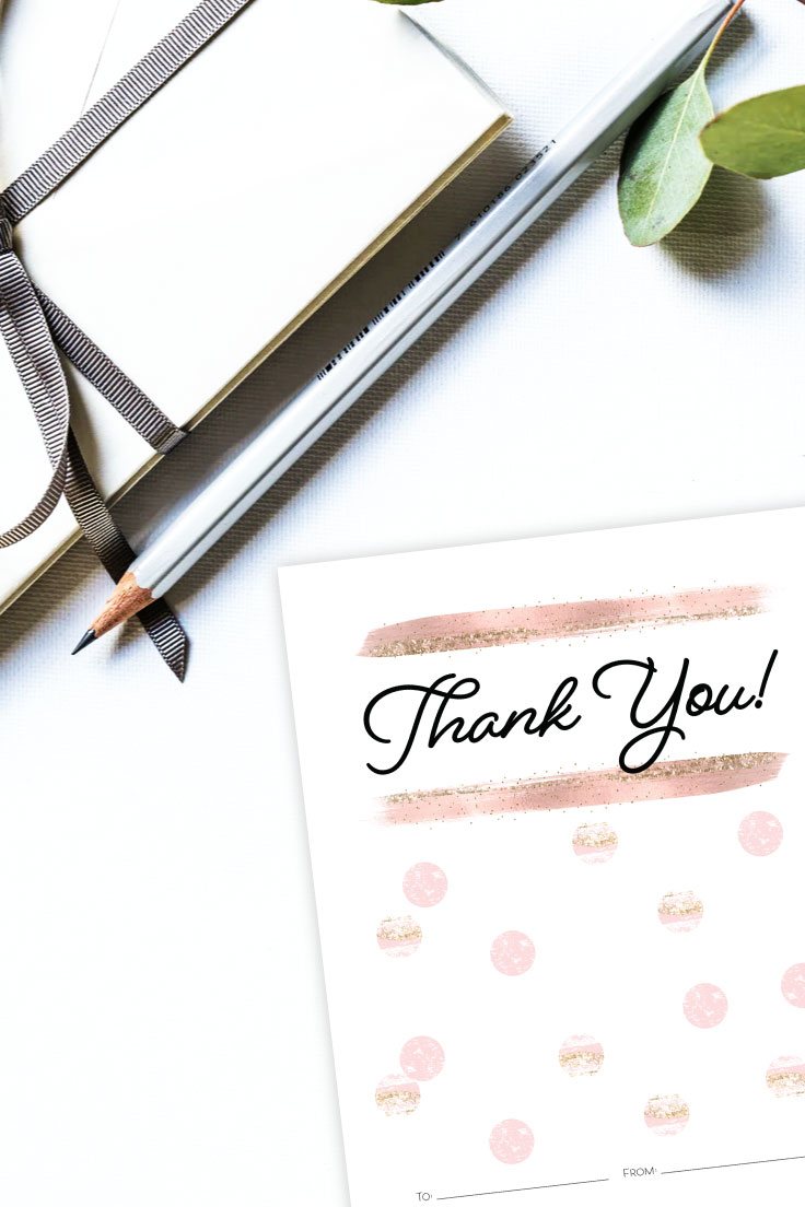 White envelopes tied in gray ribbon with pencil and Thank you! gift card holder preview on desk.