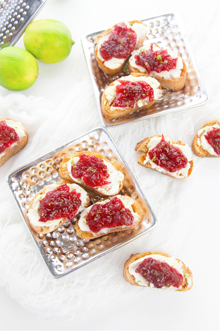 Serving dishes filled with cranberry crostini.