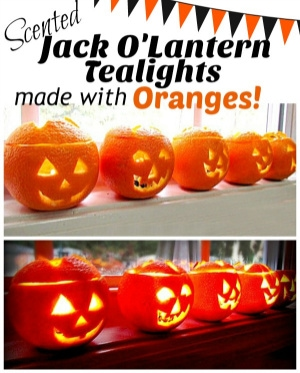 Jack o'lantern tea lights made with oranges.
