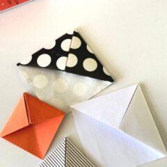 four origami corner bookmarks