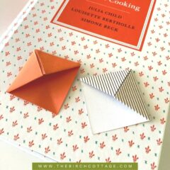 book with two origami corner bookmarks