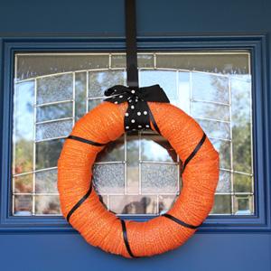 Black and orange Halloween wreath from One Mama's Daily Drama.