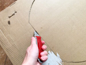 Cutting out the shapes with a box cutter.