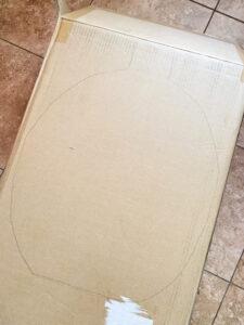 A simple pumpkin outline drawn on a cardboard box.